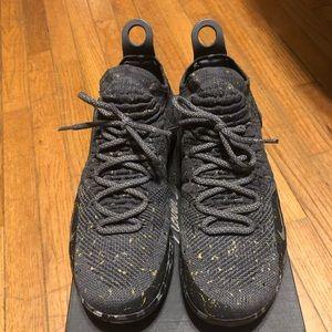 Nike KD 11 Black with gold splatter.